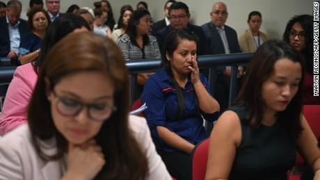 Salvadorean rape victim Evelyn Hernandez (C) appears before Ciudad Delgados court, San Salvador, on July 15, 2019. - Evelyn is facing a new trial after being temporarily released on February 9 serving a 30-year-sentence for aggravated homicide after her baby died at birth. She gave birth in April last year in the makeshift bathroom of her home in the central Cuscatlan region. She was 18 years old and eight months pregnant. She said her son was stillborn but a court in the city of Cojutepeque convicted her on July 6, 2017 of murdering him. (Photo by MARVIN RECINOS / AFP) (Photo credit should read MARVIN RECINOS/AFP/Getty Images)